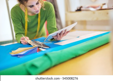 Young fashion designer working with tablet