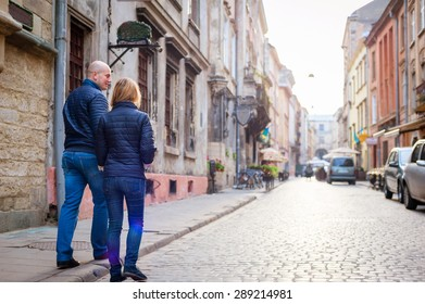 Young fashion elegant stylish couple walk  on streets of european city in summer morning