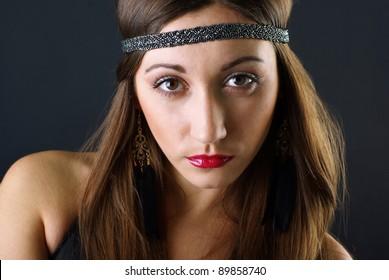 Young fashion girl posing is studio