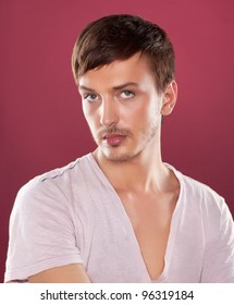 Young fashion handsome man in a white shirt over red