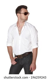 Young fashion male in white shirt and sunglasses posing looking away, over white background