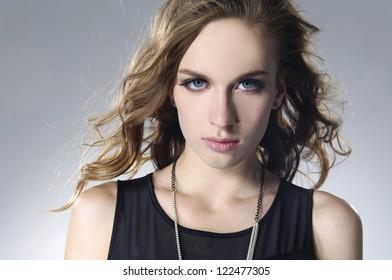 young fashion model in black dress posing