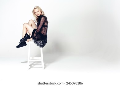 young fashion model  sitting on a chair