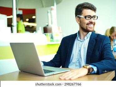 Young fashion smiling hipster man  in the city cafe during lunch time with notebook in suit