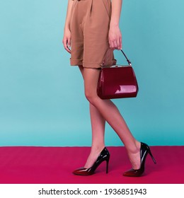 Young fashion woman hold handbag clutch isolated on background