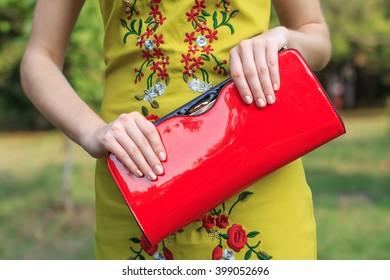 Young fashion woman hold handbag clutch