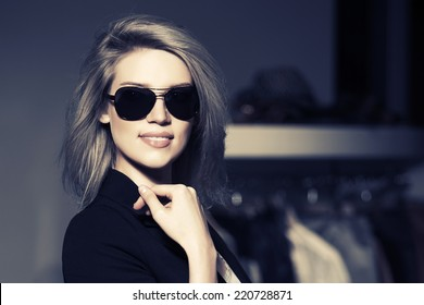 Young fashion woman in the mall interior