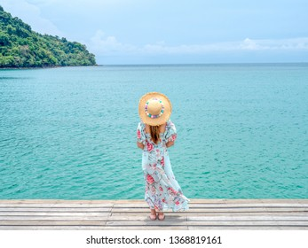 Young fashion woman relax on the seaveiw. Happy island lifestyle. The blue cloudy sky and crystal sea of tropical beach. Vacation at Paradise. travel to Maldives islands