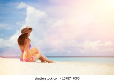 Young fashion woman relax on the beach. Happy lifestyle. White sand, blue sky and crystal sea of tropical beach. Vacation at Paradise. Ocean beach relax, travel to islands