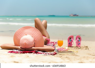 Young fashion woman relax on the beach. Happy island lifestyle. White sand, blue cloudy sky and crystal sea of tropical beach. Vacation at Paradise. Ocean beach relax.