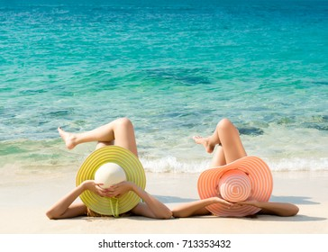 Young fashion woman relax on the beach. Happy island lifestyle. White sand, blue cloudy and crystal sea of tropical beach. Vacation at Paradise. Ocean beach relax, travel to Maldives islands