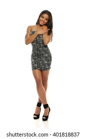 Young Fashion Woman with short dress isolated on a white background