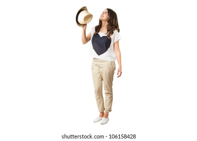 young fashionable brunette throwing a stylish hat isolated on white