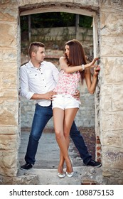 Young fashionable couple on the ruins