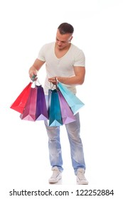 Young fashionable guy with shopping bags over a white