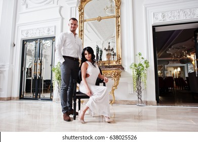 Young fashionable lovely couple at wedding anniversary and marriage proposal day indoor royal palace.