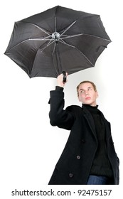 young fashionable man with umbrella over white