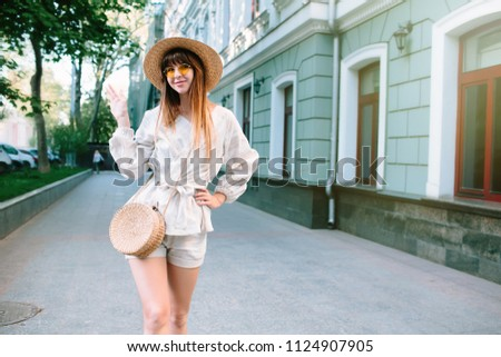6430d656a7c2 Young fashionable trendy girl posing in old city street.Close up summer  sunny lifestyle fashion portrait of young stylish boho woman walking on the  street