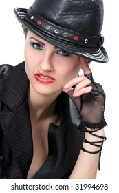 Young fashionable woman with black hat over white
