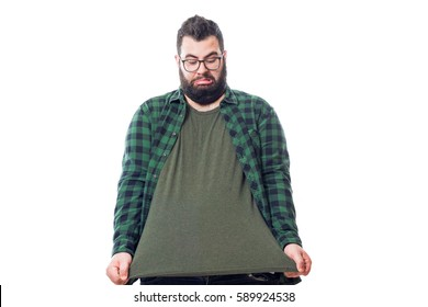 Young fat boy stretching his green plaid shirt isolated on white background