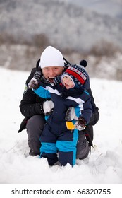 young father and a beautiful baby in the snow