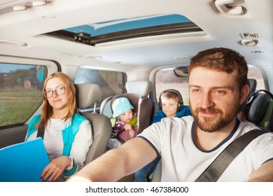 Young father driving his family car
