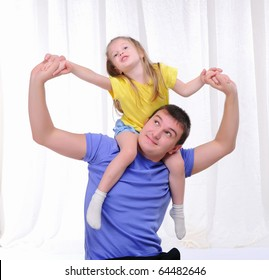 A young father has fun with his daughter