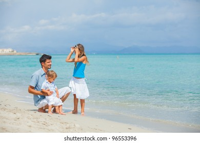 Young father with her two kids on tropical beach vacation