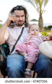 Young father and his baby girl resting at mediterranean resort