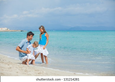 Young father with his two kids on tropical beach vacation
