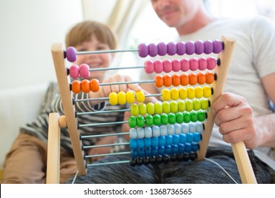 A young father on maternity leave home educates his child. The boy learns to count on color beautiful accounts.
