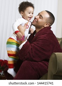 Young father smiling at baby