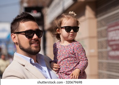 Young father walking with tiny daughter