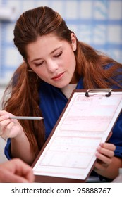 young female apprentice giving explanations about a document