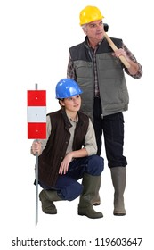 young female apprentice and senior carpenter