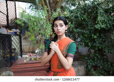 A young female artist shows looks anxious during the Lord of lanka post photoshoot on December 23rd 2018 at Sai Baba temple in Bengaluru,India