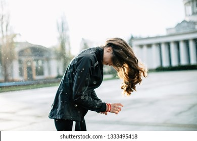 Young female athlete fixing her hair outdoors