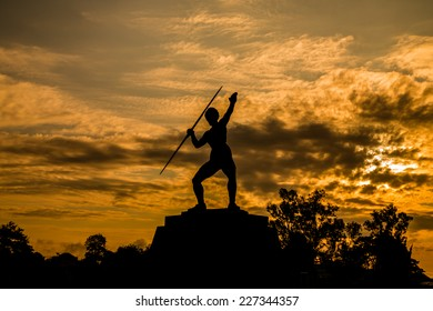 Young female athlete throwing javelin statue in Thailand