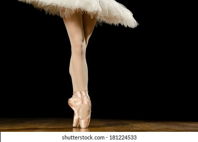 Young female ballerina standing on toes, close up shot of legs