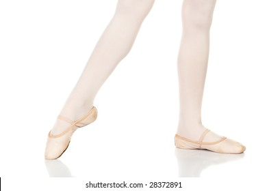 Young female ballet dancer showing various classic ballet feet positions on a white background - Point a la 2nd. NOT ISOLATED