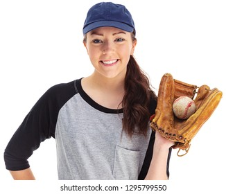 Young female baseball player in uniform, wearing a glove with ball inside.