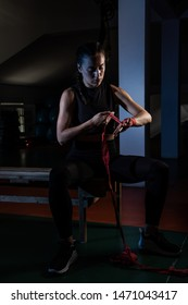 Young female boxer prepare for training in a gym.