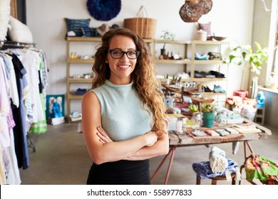 Young female business owner in a clothes shop, portrait