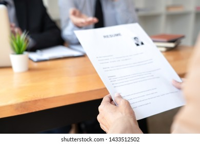 A Young Female Business women Applicant In Office Male Manager Interviewing holding resume and speaking to employer, job Interview employment and recruitment concept