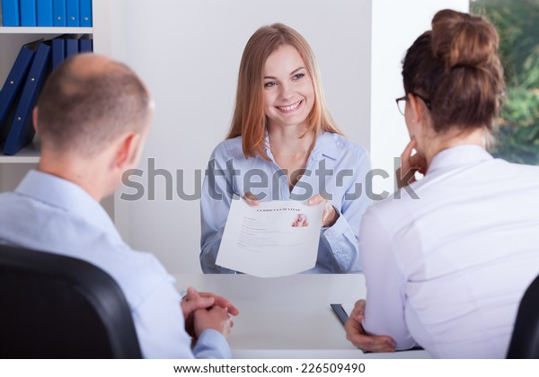 Young female candidate presenting her application on job interview