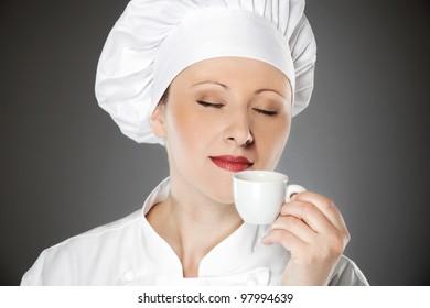 Young female chef enjoying on the coffee break