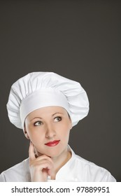 Young female chef  thinking -   bubble with copy space