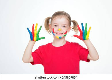 young female child with her face and her hands paint