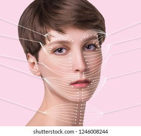 Young female with clean fresh skin. Beautiful woman. Female face and neck. Portrait of young caucasian woman at studio isolated on pastel. Short haircut, long neck, perfect skin. Lifting by gold