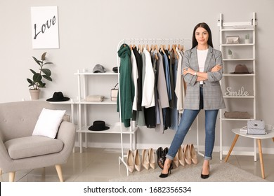 Young female clothes stylist at workplace